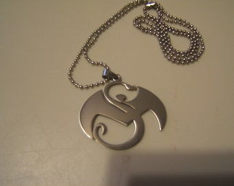 Tech N9ne Strange Music stainless steel pendant with a 30 inch ball chain