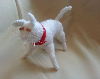hand knitted white standing cat