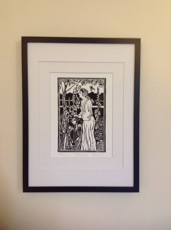 Original hand carved lino cut print titled 'Hollyhocks'. 1920s Lady and bicycle with hollyhocks  & butterfly