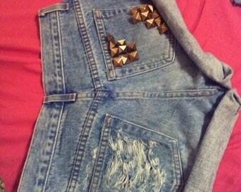 Back pocket destroyed studded on other pocket
