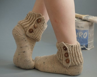 Hand knitted socks with coconut buttons