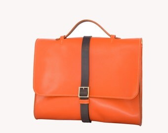The Metropolitan 505 Briefcase . Made from Vegetable Tanned Leather . Handstitched using the traditional saddle stitch .