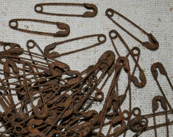 """Rusty Safety Pins ... 144 TEENY 7/8"""" long .... primitive & grungy"""
