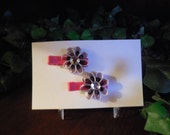 Miniature Loopy loop hot pink, black dots flower with rhinstone center hair clip
