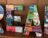 READ letters covered with book covers