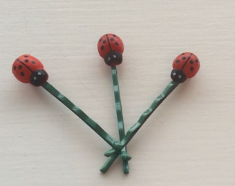 Set of 3 mini ladybirds on green kirby grips, clips, slides, bobby pins, gorgeous