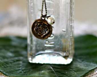 Rose pendant with pearl