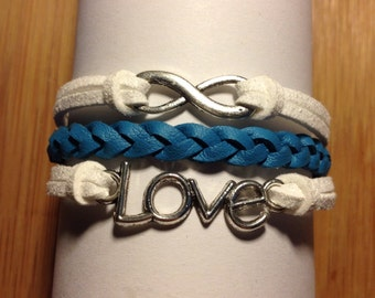 Faux leather and faux suede bracelet. Blue and white. Silver love and infinity charm