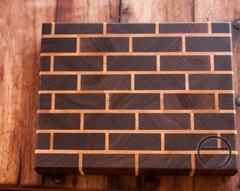 End grain cutting board in a brick and mortar pattern