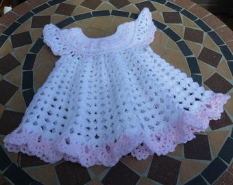 Handmade crochet baby dress. Acrylic yarn.