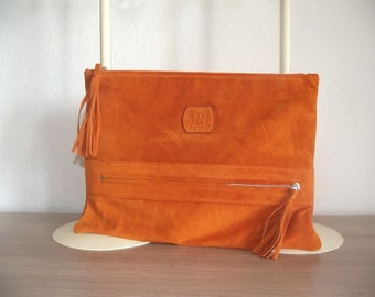 Returned leather pouch. REF: Coralie