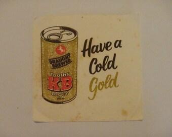 Vintage KB Gold beer coaster. Used.