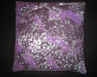 "Eggplant and violet pillow with gray and white scattered dots. Batik fabric made in Ghana. Greige linen back. Measues 16"" square."