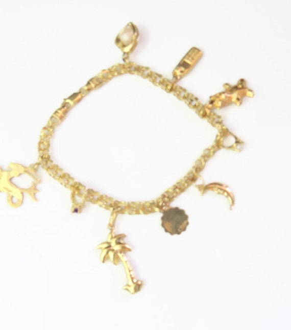 estate 14kt vintage gold charm bracelet 9 by