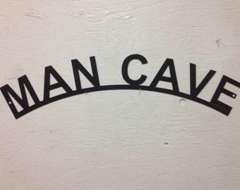 Metal Man Cave Sign