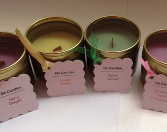 Lovely scented candles in small gold tins with clear lids and crackling wicks