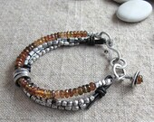 Golden Spessartite Garnet with Fine Silver and knotted Leather Bracelet