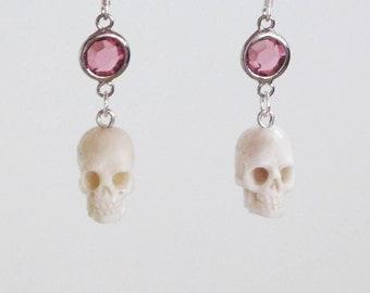 Skull carved bone earrings