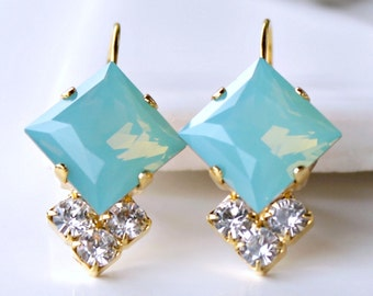 Pacific Opal Swarovski Crystals with Three Brilliant Clear Crystals on Gold Leverback Earrings