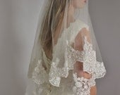Lace veil in two layers fingertip with beaded wide lace and second tier could be used as a blusher, two tier lace veil with silver or gold