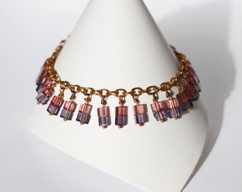 "Gold bracelet with purple cube bead dangles ""Peacock"""