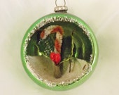 Vintage Christmas glass diorama ornament green with chenille candy cane holly and silver glitter