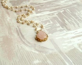 Delicate pearls necklace with rose carved rose quartz pendant
