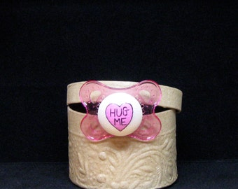 Hug Me Conversation Valentine Heart Hand Painted on a Pink MAM Pacifier by PiquantDesigns