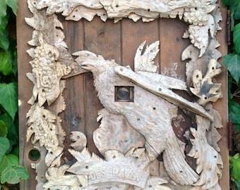 1940s tramp art salvage Edgar Allen Poe Raven wood on barn door with peep hole flower floral bird motif