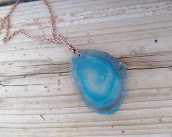 Beautiful shades of blue swirl agate slice on copper chain