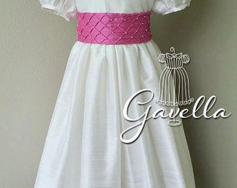 Girls custom silk dupioni dress with band trimmed sleeves and beaded sash. Free matching bow. Two colors of your choice.