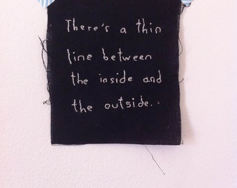 "PATCH, ""There's a thin line between the inside and the outside"" hand embroidered"