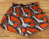 Summer shorts: Orange & black swirls elastic Ruffle waist shorts - UK size 10 / waist 26 inches. Ships from USA