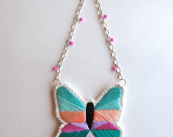 Geometric butterfly necklace hand embroidered with mint emerald green purples peach on cream muslin felt back and sterling silver chain