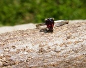 Pear Cut Garnet Solitaire Ring In Sterling Silver