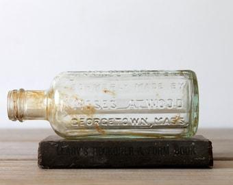 Vintage bitters glass bottle / aqua / pale blue green / rustic home decor / patina / medicine bottle / for altered art / man cave decor