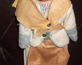 Vintage composition faced jointed doll 11 inches tall in a complete outfit in good condition
