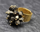 Pyrite Dangle ring made with a textured gold plated brass base and Faceted Pyrite nuggets