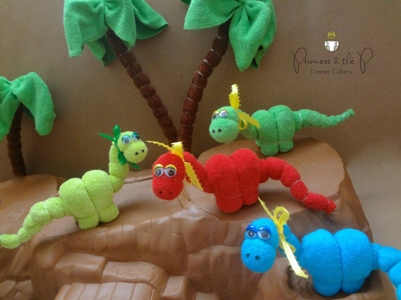 baby washcloth dinosaur diaper cake by princessandthepbaby on etsy