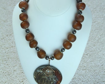 Large African Raku Pendant on Glass Beaded Necklace