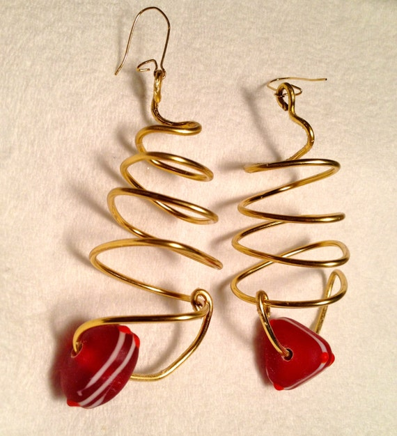 Brass earrings with wire work and red triangular glass bead with white stripes and bright red dots