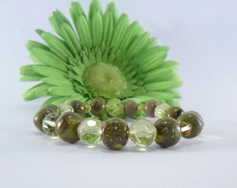A Green and Yellow Stretch Beaded Bracelet. Green Clay Beads are Complemented by Glass Yellow Beads. A Bracelet like No Other!