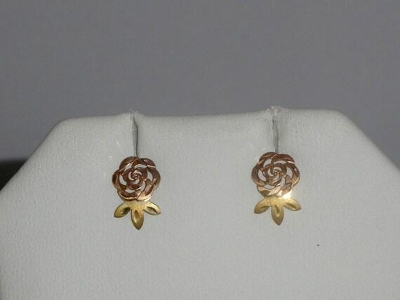 dainty 14 karat yellow gold post earrings by