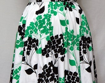 Semi fitted gathered skirt, zip to side, hemline sits just above the knee