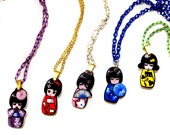 Cute colorful kokeshi doll // Japanese doll // Acrylic laser cut pendant charm necklace. Available in blue, green, red, purple yellow colors