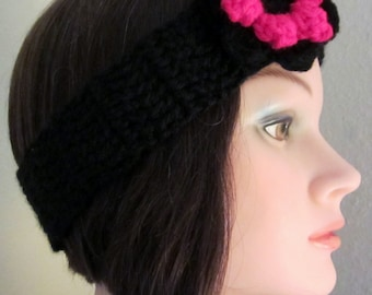 Headband, woman's crochet accessory for her hair. The headband is embellished with a black and red crochet flower.