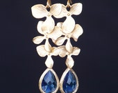 A Trio of Matte Gold Flowers with Sapphire Blue Teardrops Framed in Gold, Long Dangle Earrings