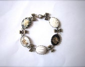 Cabochon bracelet in cream, gold and black