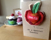 Teachers gift card which includes a hand felted apple fridge magnet embroidered with the words