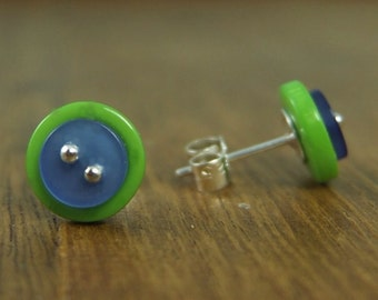 Double button stud earrings with sterling silver posts and scrolls.
